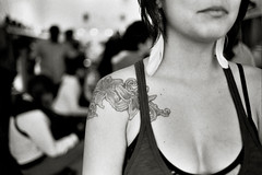 the girl with the flower tattoo (*Cinnamon) Tags: sf film nikonf100 shopgirl thehaight nikkor50mmf14 fujineopan400bw