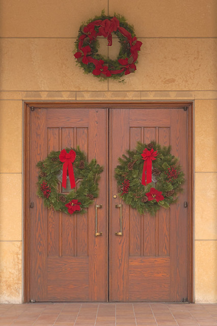 Saint Gabriel the Archangel Roman Catholic Church, in Saint Louis, Missouri, USA - door with Christmas wreathes