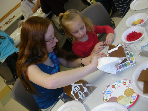 Dec 24 2010 Ila and Haley making gingerbread houses