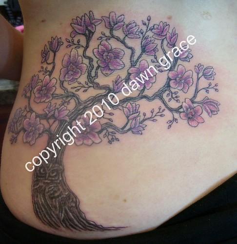 magnolia tree tattoo. Magnolia tree with owl trunk