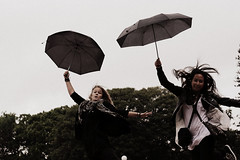 Caught by the wind (Ditte Hallig) Tags: rain umbrella canon 50mm jumping f14 sydney australia usm umbrellas ef 1000d