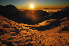 december sun (.:: Maya ::.) Tags: sunset orange sun mountain snow color eye nature trekking golden maya outdoor magic bulgaria  pirin      mountainsnaps mayaeye mayaeyecom  tevnoezero mayakarkalicheva  wwwmayaeyecom