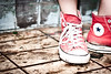 chucks in the mud (catchacandela) Tags: red feet foot shoes mud leg dirty step converse taylor sneaker chuck chucks