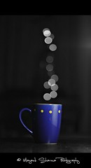 A mug of hot bokeh ! [EXPLORE] January 11 2011 (Mayank Sharma renewed :D :D) Tags: blue bw black hot home yellow canon table 50mm lights evening dof purple bokeh background mug wjite selectivecoloring purplemug