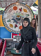 In Conflict - DSC 8073 090610 (Eric.Parker) Tags: canadian national exhibition 2010 cne muslim hijab niqab modesty gambling midway fairgrounds funfair