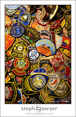 St. Pauls FirePatches (Steph Sawyer Photography GRAND TETON Bound) Tags: newyorkcity church canon worldtradecenter 911 exhibit patches stpaulschapel episcopalchapel arishoftrinitychurch firemanpatches policemanpatches healingheartsandminds