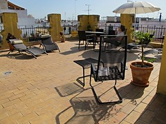 Catherine on the roof of our apartment, Seville (ali eminov) Tags: sevilla spain rooftops furniture seville andalucia roofs espana catherine tables andalusia worldtravel catherinerudin