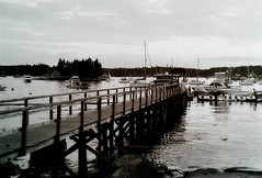 Maine pier (Emily Taliaferro Prince) Tags: blackandwhite water harbor pier boat maine
