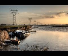 Snip (Focusje (tammostrijker.photodeck.com)) Tags: winter sunset sky snow clouds landscape boat electricity sunken snip capsize electricitypole whereissnap
