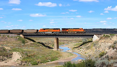 Roadside Attraction (view2share) Tags: bnsf9728 bnsf6332 sd70mac repaint ge generalelectric gevo emd electromotivedivision engine eastbound coal coalcar unitcoaltrain mt montana easternmontana west western yellowstonevalley ofalloncreek bridge trestle viaduct creek river valley vista sky clouds deansauvola august202016 august2016 august 2016 railway railroading rr railroads railroad rail rails railroaders rring roadtrip trains track train transportation tracks transport trackage trees travel freight freighttrain freightcar freightcars h3 fallon forsythsub summer bnsf bnsfrailway burlingtonnorthernsantafe