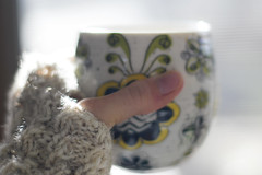 they couldn't be lovelier (jamie {74}) Tags: coffee 35mm handknit mug knitted dailyphoto wristwarmers featured fingerlessgloves thankyousam sooc nikond40 shootingintothelight thematernallens iwearthemallthetimealready mydaughterandiarefightingoverthemseriously shootingintothewindow