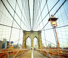 Brooklyn Bridge, New York (Tomasito.!) Tags: new wood york city nyc bridge light people urban panorama usa brown newyork tourism apple lamp lines metal brooklyn america photoshop vintage buildings macintosh big mac nikon post suspension steel bricks perspective landmark tourists symmetry historic brooklynbridge railings bigapple hdr touristspot 18105 d90 vertorama mygearandmepremium mygearandmebronze mygearandmesilver