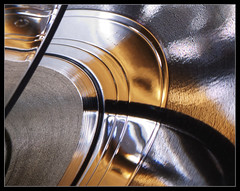 Curves and groves, HMM! (Ianmoran1970) Tags: light abstract colour reflection glass shiny track shine image vinyl picture groove hmm teenage strobist ianmoran doubleexplore macromonday ianmoran1970