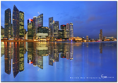 singapore marina bay (fiftymm99) Tags: road travel urban building skyline skyscraper marina river lights one hotel office singapore asia waterfront bank tourist esplanade cbd residential fullerton singaporeriver ntuc swissotel ura cliffordpier marinabay uob onefullerton nikond300 fiftymm99