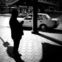 10:18 December 14 2010 (daveweekes68) Tags: shadow blackandwhite man cars silhouette japan standing taxi tokushima 2010 iphone  iphoneography