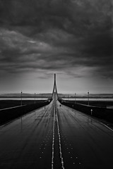 Portal (tristanlb) Tags: road bridge light sky bw storm rain architecture clouds canon dark landscape eos vanishingpoint blackwhite intense scary highway empty horizon perspective dramatic obscure frightening tristanlb