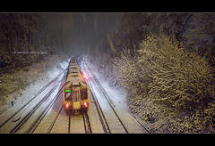 Polarizing Express ... (Rob Overcash Photography) Tags: winter snow storm southwest night train canon nocturnal tracks atmosphere rail overground inclementweather robotography 5dmkii snowmeggedon robovercashphotography justsaynotobumping readingtowaterloo