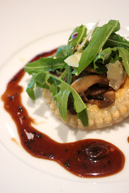 Wild Mushroom Tart with Rucola and Shaved Parmesan