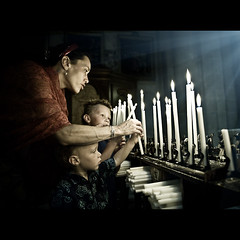Lighting Candles (PMMPhoto) Tags: family blue red portrait italy orange church boys loss paul nikon candles photographer dof child bokeh glasgow  mcgee lifestyle tuscany flare remembrance hamish nikkor fp lachlan alix arezzo lanarkshire strathaven lightingcandles 2470mmf28 paulmcgee d700 donotusewithoutpriorpermission pmmphoto paulmcgee