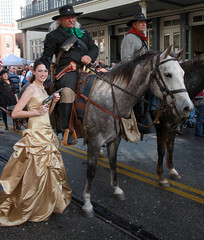 The Lady and The Officers (wyojones) Tags: christmas horse woman holiday black galveston girl beautiful beauty smile hat festival strand necklace eyes pretty texas boots teeth victorian hats curls lips pistol brunette lovely gown bandana browneyes saddle reenactors holster cowboyhats rebels confederates dickensonthestrand victorianholiday wyojones texasfirst