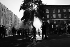 Shower of light (Che-burashka) Tags: street light summer people blackandwhite bw london smoke places bn nottinghill nhc londonist showeroflight londonsummer chasinglight