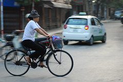 relaxing ride on Hanoi street (Adam Lai) Tags: street man bicycle vietnamese vietnam busy delivery hanging hanoi panning squeezing