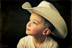 Mammas Don't Let Your Babies Grow Up to Be Cowboys (Rebecca812) Tags: family boy portrait white cute texture beautiful hat childhood horizontal studio costume cowboy sweet blueeyes profile innocent dressup son lookingup 3years cowboyhat rosycheeks oneperson blondhair canon5dmarkii skeletalmess familygetty2010 rebecca812 heritage2011