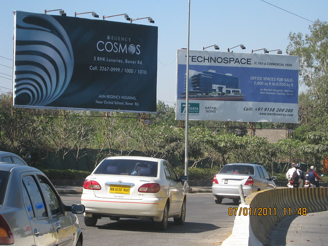 Hoardings of Regency Cosmos Almost ready for possession 3 BHK Flats & Technospace IT Park - Real estate on Baner Road Pune