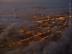 Denver through the clouds (Shiny Dewdrop) Tags: skyline clouds plane evening twilight nightlights dusk aircraft wing aerialview aerialphotography snowcities