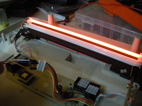 Power to light red cold cathode tube
