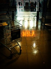 Refuge II (Paul..Andrews) Tags: cameraphone reflection apple rain dundee sainsburys 3gs iphone spnp stre trollley iphoneography instruction16
