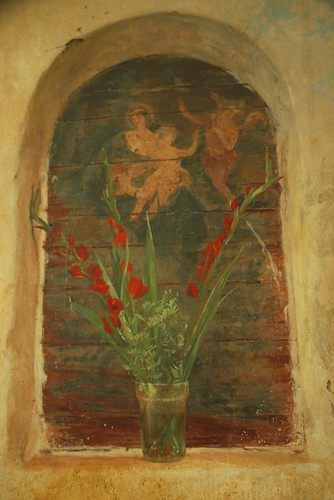Mary with baby Jesus and angel, red flowers in a jar, niche painting, Healdsburg, California, USA by Wonderlane