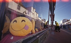 Smile (4foot2) Tags: smile candid streetphoto streetshot street streetphotography reportage reportagephotography people peoplewatching peopleofbrighton interestingpeople shop shopwindow brighton northlaines laines worker closeup close analogue film filmphotography 35mmfilm 35mm oldfilm outofdatefilm expiredfilm experimental moviefilm fujifilm reala500d ecn2 remjet remjetremoval washingsoda colourfilm zorki1 zorki voigtlander15mm voigtlander superwideangle 15mm 2016 fourfoottwo 4foot2flickr 4foot2photostream 4foot2 lightleaks