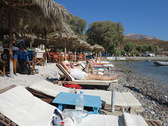 relaxing on the beach (squeezemonkey) Tags: kalymnos greece beach sunbeds sunbathing bar shore sea