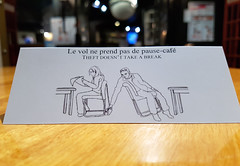 Stealing your purse (Exile on Ontario St) Tags: theft warning avertissement sign paper papier signe vol pausecaf montreal break stealing thieve thieves voleurs voleur public table tables restaurant folded carton cardboard belongings watch