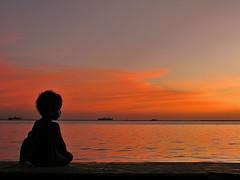 i'm just a kid (explore) (DOLCEVITALUX) Tags: sunset sea cloud sun love tourism beautiful canon boat nikon pretty ship tour child philippines rich ecotourism somes dolcevitalux