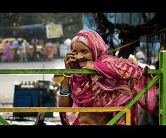 Sweet fruits of technology (cybershots (Subin Paul)) Tags: street old day2 woman india west mobile lady canon paul eos phone age mobilephone kolkata bengal efs subin 550d img3127 cybershots 50250 babughat wwwsubinpaulcom 50mmphone