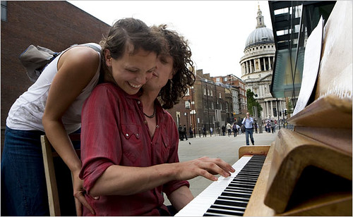 Trying out one of the 30 pianos placed around London, this one at the Millennium Bridge.