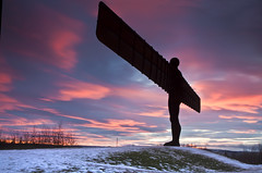 Angel sunset (Mike Ridley.) Tags: longexposure winter sunset sky sculpture sun snow color colour art silhouette angel clouds canon newcastle landscape gateshead explore angelofthenorth explored graduatedfilter canon50d leefilters
