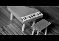 . (OrangeRy ~ Sara) Tags: white black macro up lens toys 50mm chair nikon focus sara close little piano d90 اسود سارا ساره ابيض العاب بيانو