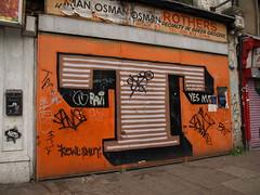 Eine: T (Alex Ellison) Tags: urban streetart shop graffiti tag ravi shutter letter smut kewl eastlondon sput onlyjoe 10foot