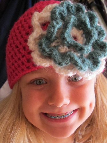 Cute girl with her crocheted hat gift