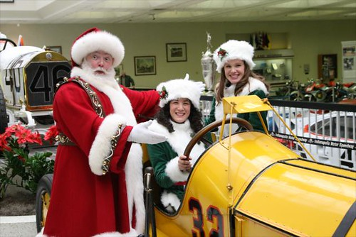 Santa and his elves debate trading in his sleigh for a nicer ride