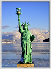 Lady Liberty over Lake Pend Oreille (Explored) (misst.shs) Tags: winter nikon explore statueofliberty sandpoint ladyliberty hcs northidaho lakependorielle d90 cabinetmountains explored sandpointcitybeach clichesaturday