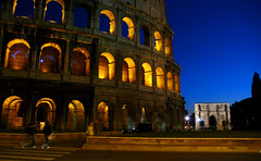 colosseum - like magic (Csbr) Tags: street city travel blue winter light sky italy orange rome history architecture night ancient ruins europe december arch capital amphitheatre constantine colosseum classical worldheritage 2010 panasoniclx2 gettyscreening