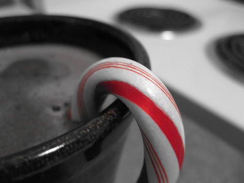 Candy cane in dark hot chocolate