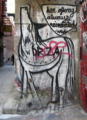 her glory always reinstated (Robert Saucier) Tags: street red horse usa streetart newyork building wall architecture rouge cheval grey gris graffiti pavement manhattan lowereastside staircase rue mur escalier younggirl drza jeunefille wgg img0689