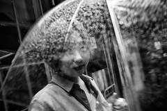 at the eye of the storm~ Shanghai (~mimo~) Tags: 1933 architecture asia china hongkou mimokhairphotography shanghai slaughterhouse streetphotography girl umbrella rain drops bokeh blur movement