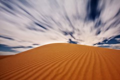 Bury Alderman In The Sand (Jeff Engelhardt) Tags: clouds long exposure wind dunes imperial