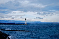 The Lighthouse (mauson) Tags: city blue mountain lake beautiful clouds landscape faro boats lago rocks europe nuvole wind blu swiss cliffs cielo svizzera rocce acqua genve ginevra paesaggio citta d40x